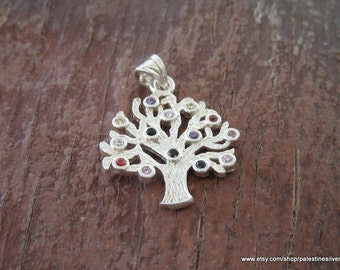 Silver pendant tree decorated by beautiful colored chrystals
