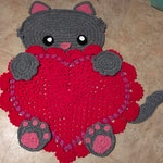 Crocheted cat and heart rug