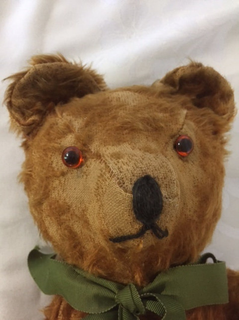 Large antique jointed straw-stuffed teddy bear with worn cinnamon-colored fur and old pad replacements 19 12