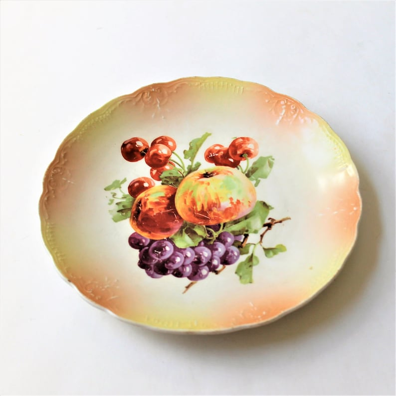 and berries and green rust cottage d\u00e9cor fruit Mismatched plates for wall display in coordinated shades of peach nuts