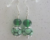 Emerald green and white earrings on silver ear wires with lampwork glass beads. Artisan lampwork, SRA, Chrys Art Glass