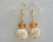 Amber and white earrings on gold ear wires with lampwork glass beads. Artisan lampwork, SRA, Chrys Art Glass