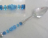 Grapefruit Spoon. serrated. Featuring handmade artisan lampwork beads by Chrys Art Glass