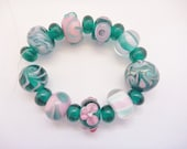Beads, Lampwork Glass Bead Set in teal green and pink. 18 beads, 9 design beads and 9  spacers. Artisan lampwork, SRA, Chrys Art Glass