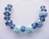 Lampwork Glass bead set consisting of 15 beads in beautiful transparent denim blue  with sky blue highlights. SRA artisan