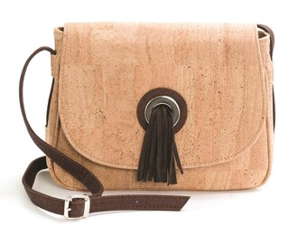 Saddle bag with pompon in suede
