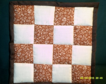 patchwork potholder/hot pad in brown and rust
