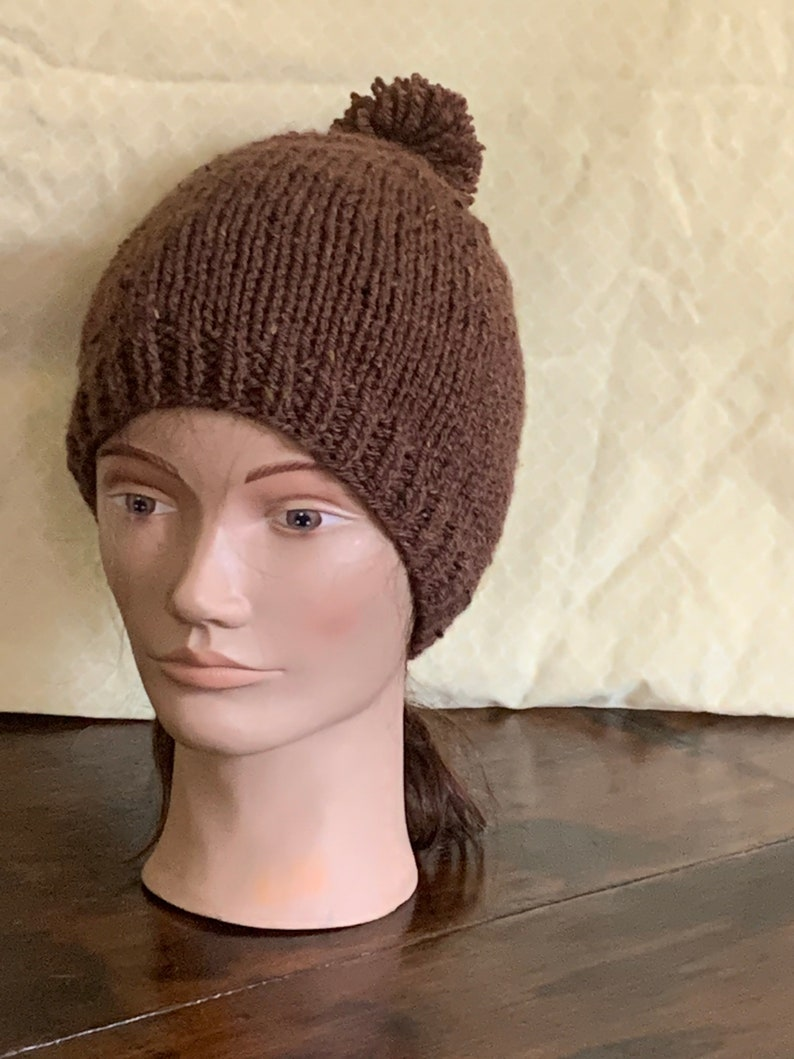 Adult knitted brown beanie hat with pompom