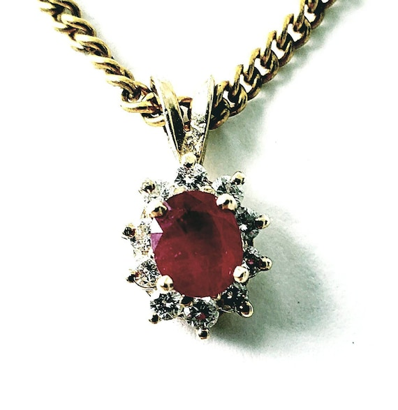 14k ruby & diamond halo pendant
