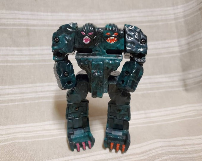 Rock Lords, Vintage GoBots 1985 by Tonka. Sticks 'n Stones, Series 1  action figure . Transformer like Toy Robots.