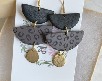 Classic size, cheetah print and black clay half circle linked earring connected to a brass teardrop
