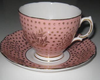 ENGLISH COLCLOUGH CHINA Cup and Saucer, Pink with gold design with stars