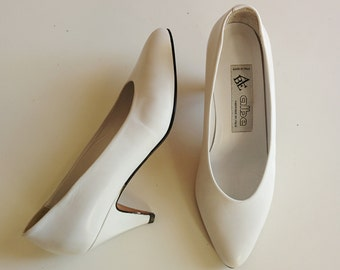 80s white almond toe pumps with kitten heels