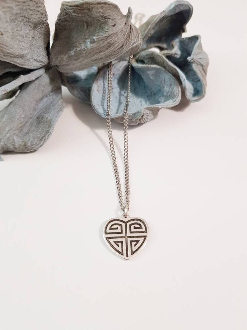 Necklace with a heart pendant with meanders in silver antique