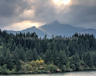 Sun Peeking Through Storm Clouds Over the Olympic Mountains Along the Columbia Gorge  -- Prints, Matted and Mounted, Framed, Canvas, Metal