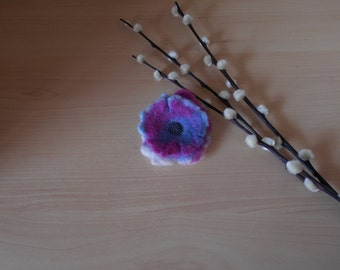 Double Frill.  Hand felted brooch.  Blue, Pink and White pieces of wool felt layered with a centre of indigo blue beads.