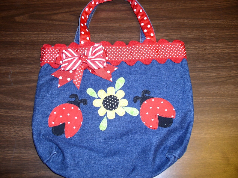 Stonewash Blue Canvas Tote; Velcr0 Closure; 2 Lady Bugs Yellow Flower with Polka Dot Center Appliqu\u00e9 by Emanuel/'s Wearable Art