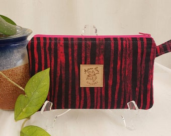 """Zippered 8.5"""" x 5"""" clutch/wristlet, Black and red stripes with red lining, fits newer 9+ phones, license/credit cards/cash, etc"""