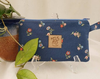 """Zippered 8.5"""" x 5"""" clutch/wristlet, Garden flowers on blue with orange lining, fits newer 9+ phones, license/credit cards/cash, etc"""