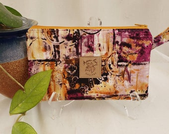 """Zippered 8.5"""" x 5"""" clutch/wristlet, layered splashes of plum with plum lining, fits newer 9+ phones, license/credit cards/cash, etc"""