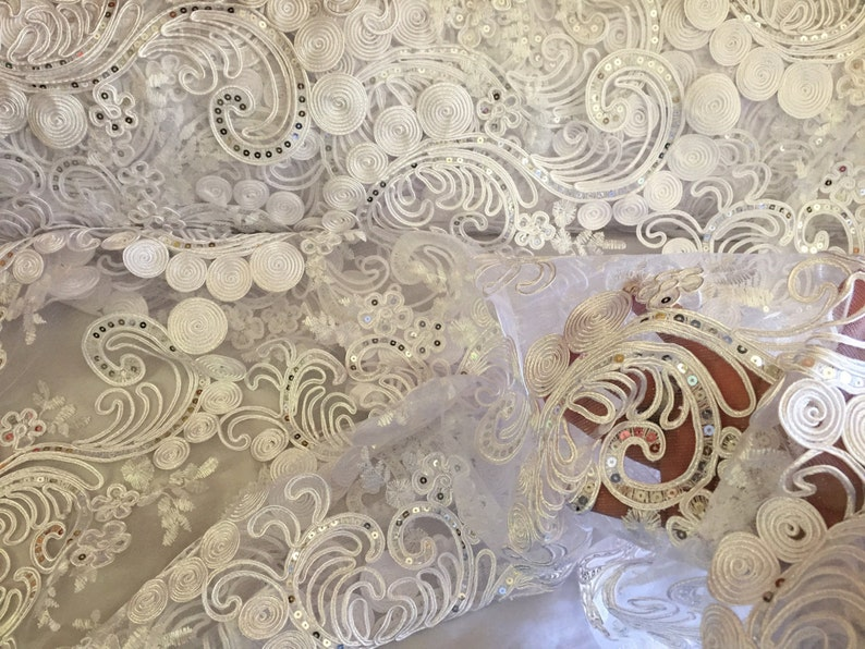 White flower swirls corded with sequins on a mesh lace-wedding-bridal-prom-nightgown-decorations-sold by the yard.