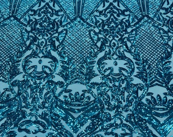 Turquoise shiny sequin damask design on a 4 way stretch mesh-sold by the yard.