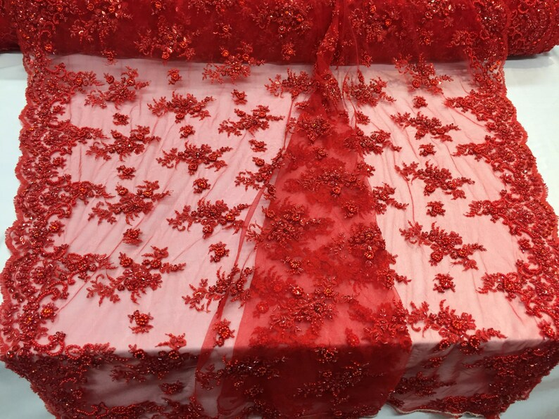 Red appealing flowers embroider and beaded on a mesh lace-prom-nightgown-decorations-dresses-sold by the yard.