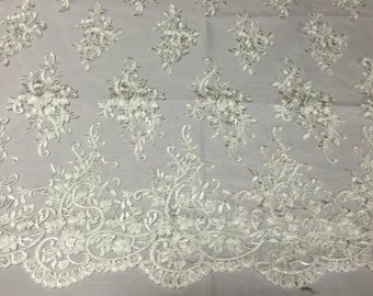 Ivory classy paisley flowers embroider on a mesh lace -yard