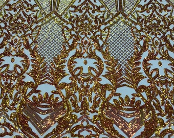 Orange iridescent sequin damask design on a nude 4 way stretch mesh-sold by the yard.
