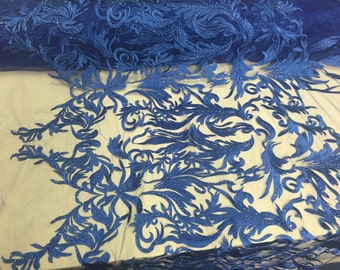 Rotal blue rhinestone vines embroider on a mesh lace fabric -sold by yard