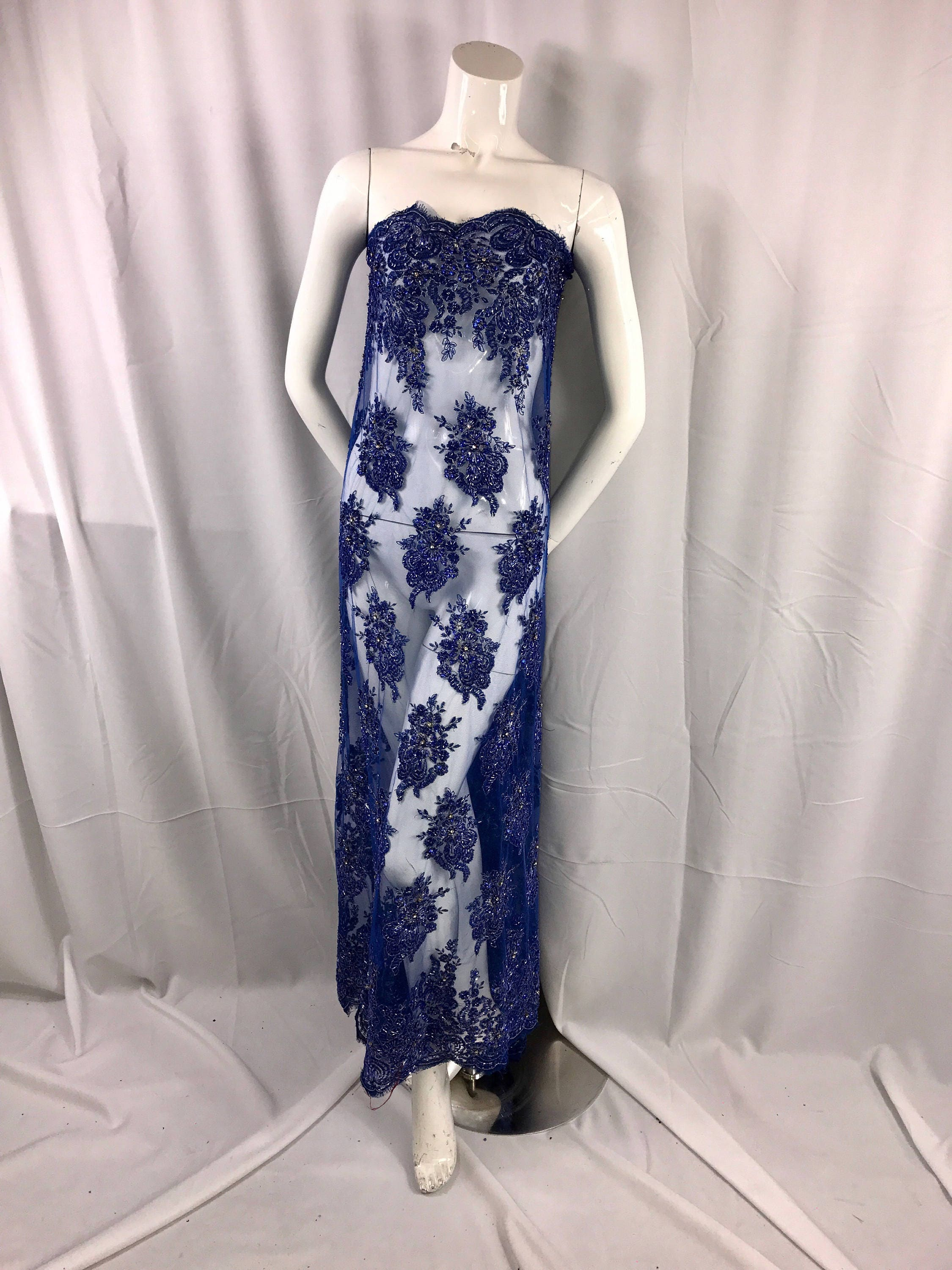 Royal Blue Flowers Embroidsr And Heavy Beaded On A Mesh Lace Fabric