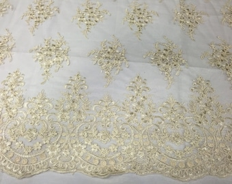 Dark ivory royal flower design embroider widh sequins and corded on a mesh lace -yard