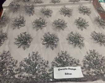 Gray/silver gaviota design embroider and beaded on a mesh lace. Wedding/Bridal/Prom/Nightgown fabric. Sold by the yard.