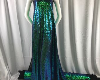 Green/purple iridescent mermaid fish scales-mini sequins embroider on a black mesh fabric-fashion-decorations-dresses-sold by the yard-