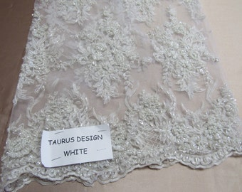 Gorgeous white French design embroider and beaded on a mesh lace. Wedding/Bridal/Prom/Nightgown fabric.