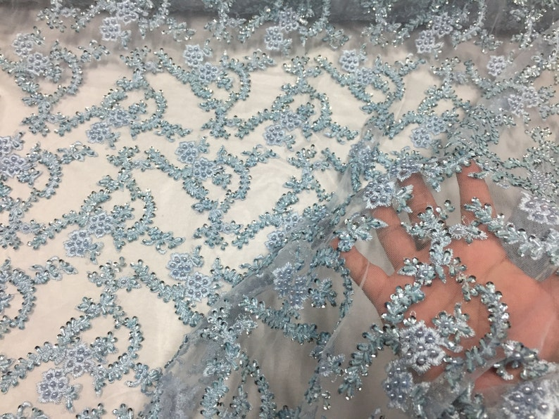 Majestic light Blue Shinny vine design embroider and heavy beading on a mesh lace-prom-nightgown-decorations-dresses-sold by the yard.