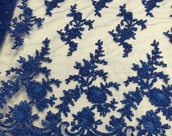 Royal blue appealing flower design embroider and beaded on a mesh lace-prom-nightgown-decorations-dresses-sold by the yard.