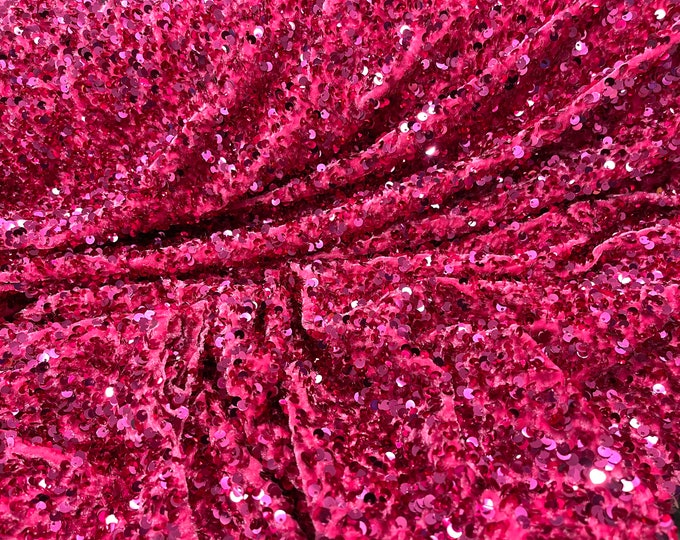Fuchsia Shiny sequins all over a stretch velvet , sold by the yard.