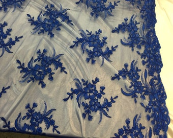 Royal blue hibiscus flower design embroider and corded on a mesh lace -yard