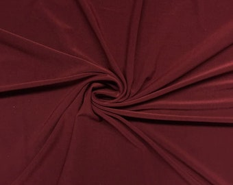"""Wine 58/59"""" Wide ITY Fabric Polyester Knit Jersey 2 Way  Stretch Spandex Sold By The Yard."""