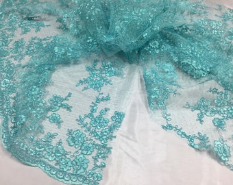 Sensational aqua flowers Embroider And Corded On a mesh lace-prom-nightgown-dresses-decorations-sold by the yard.