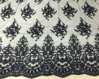 Navy blue royal flowers embroider with sequins and corded on a mesh lace -yard