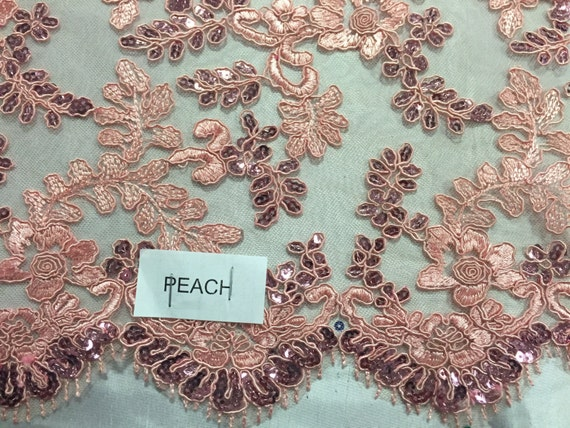 Peach corded flowers embroided with sequins on mesh lace fabric - yard