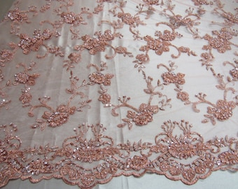 Elegant blush peach French design embroider and beaded on a mesh lace. Wedding/Bridal/Prom/nightgown fabric .