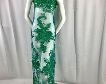 Green 3D floral design embroider with sequins and hand beaded with metallic tread on a mesh lace-dresses-fashion-prom-sold by yard.