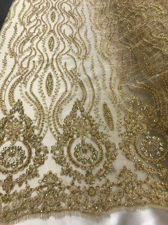 LIGHT GOLD PRINCESS DESIGN EMBROIDER SEQUINS ON A BLACK 4 WAY STRETCH POWER MESH