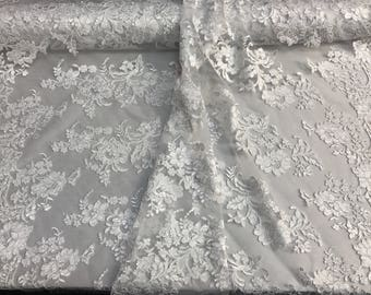 White floral design embroider and corded on a mesh lace fabric-fashion-decorations-nightgown-prom-sold by the yard.