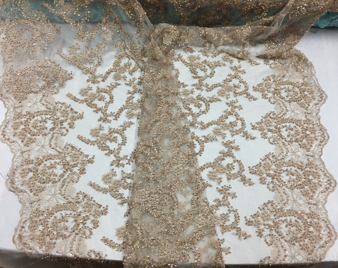Majestic old gold shinny vine design embroider and heavy beaded on a mesh lace-prom-nightgown-decorations-dresses-sold by the yard.