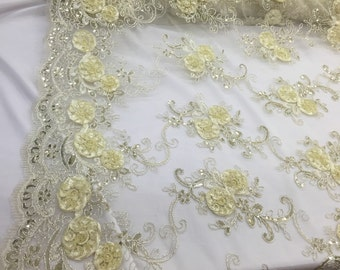 Dk.ivory 3d flowers embroider with sequins on a ivory mesh lace. Wedding/bridal/prom/nightgown fabric. Sold by the yard.
