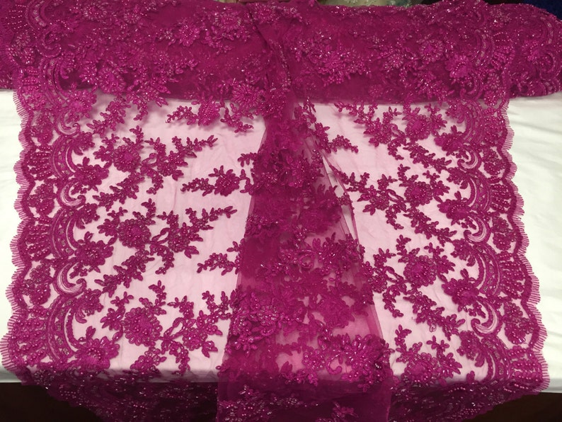 Fuchsia appealing flower deisgn embroider and beaded on a mesh lace-prom-nightgown-decorations-dresses-sold by the yard.